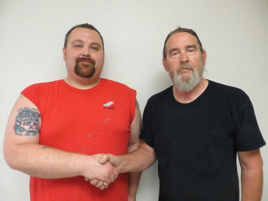 D.L. Martin Co.'s Employee of the Month Justin Robinson (left), is congratulated by his supervisor, Jack Huffman.