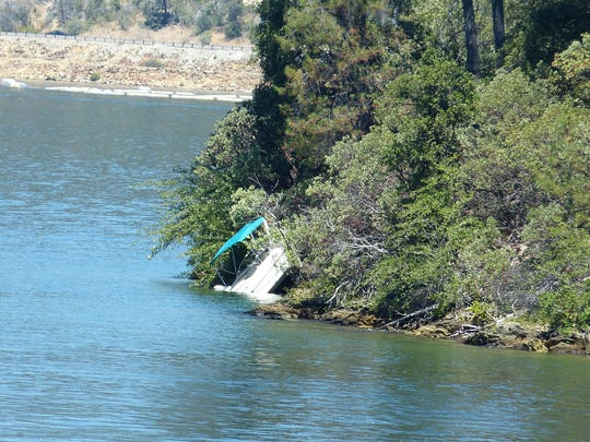 A boat ran aground Thursday at Whiskeytown Lake, injuring two.