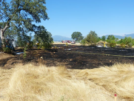 Firefighters quickly put out Tuesday a one-acre fire