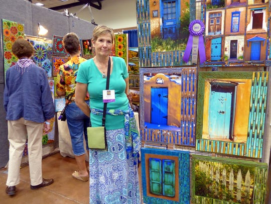 Patty O'Connor poses at her booth, Patty's PIeces,