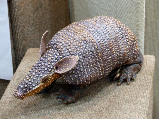 Artist Karen Bell creates detailed reptile and amphibian sculptures, as well as a few insects and mammals like this armadillo.