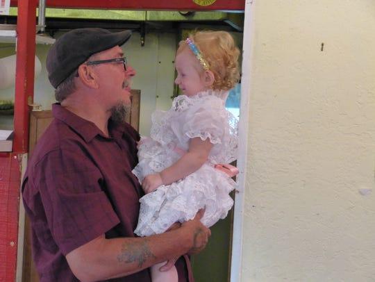 Big Dipper Café owner Ken Dalton holds his 20-month-old