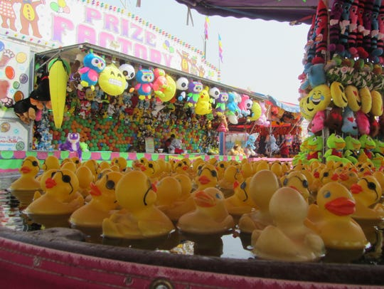 Rubber ducks bob along, waiting to be snagged by a lucky winner at Montana State Fair.