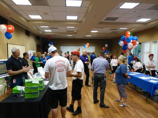 People gathered in the Redding City Hall Community Room to celebrate National Night Out indoors.