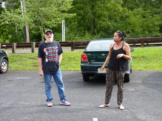 Jim Girvan, of Branchburg, and Analilia Mejia, director of New Jersey Working Families Alliance, speaks to activists before embarking on the People's Motorcade.