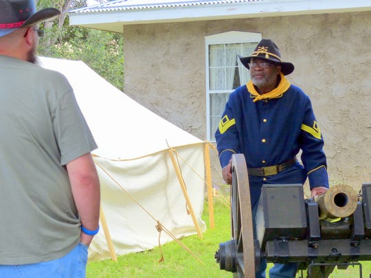 """A """"Buffalo"""" soldier explains how cannons were used during military engagements."""