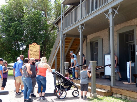 A line formed waiting for tours of the former Lincoln County Courthouse that became the site of a jail break by Billy the Kid, who fatally shot two lawmen.