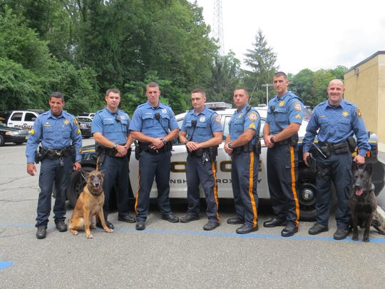 Roxbury Police and Morris County Sheriff's officers who help catch four attempted burglars last week united to thank the two K-9 officers for their contribution. Left to right: Morris County Sheriff's Sgt. Aaron Tomasini and K-9 officer Sigmund, Roxbury Ptl. Brett Barbera, Roxbury Ptl. Steven Strowbridge, Roxbury, Ptl. Nicholas Ponomarev, Sgt. Steve Catalano, Cpl. Eric Weaver, Sheriff's Det. Michael Carbone and K-9 officer Loco.