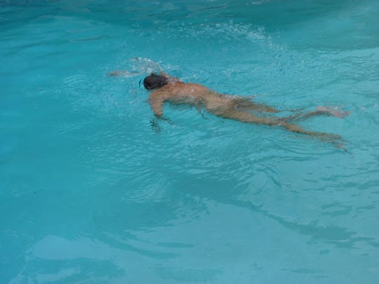 Jeanette Watt swimming in the pool at Sky Farm. A new member, she says she has been welcomed with open arms.
