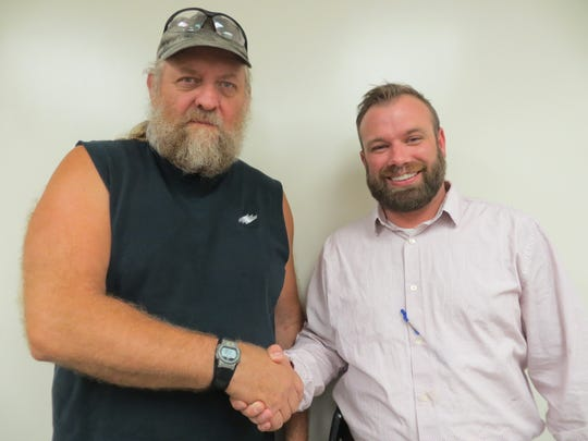 D.L. Martin Co.'s Employee of the Month Mike Wood (left), is congratulated by his supervisor, Jason Moore.
