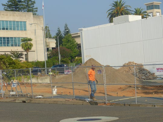 The demolition of the sheriff's building is being done to make way for a new courthouse.