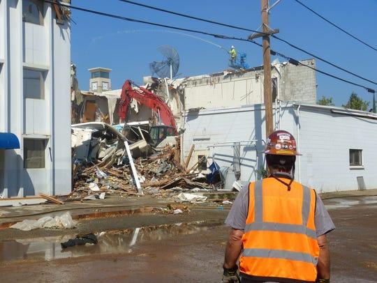 Work began Tuesday to demolish the former Sheriff's