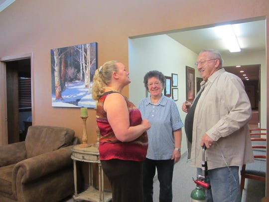 Virgil Pfeifle, right, and his wife Elsie, center, talk with an employee at Rocky Mountain Sleep Disorders Center, where Virgil was treated for sleep apnea.