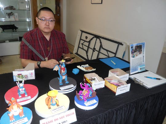 "Clinton G. Mesa of Ordot presented his collection of dragon sculptures and other clay art at Guma Mami Inc.'s 18th Annual Creative Spirits Art Exhibit, ""Navigating the Tactile Realm"" which was held at the Nissan Art Gallery, Upper Tumon on Aug. 25. The Exhibit featured arts and a silent auction by persons with disabilities and donated pieces by local artists. Clinton was a featured instructor for the CAHA 3-dimensional Art Project sponsored by Guma Mami, Inc.  He conducted a series of clay modeling workshops which were held on Saturdays, April 29 thru June 10 at the Guam Developmental Disability Council (GDDC) training room at the Castle Mall, Mangilao."