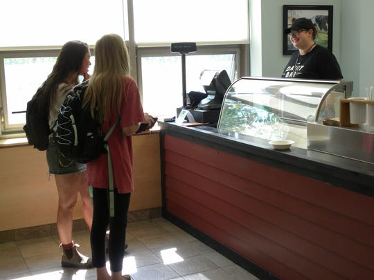 Students place an ice cream order at the UVM Dairy Bar.
