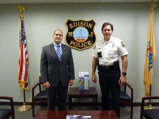 Middlesex County Prosecutor Andrew Carey and Edison Police Chief Thomas Bryan at the entrance to Edison Police Headquarters