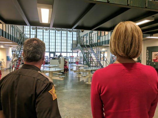 Vanderburgh County Sheriff Dave Wedding and Lt. Gov. Suzanne Crouch (right) look at the women's area of the county jail. The section of the jail is designed to hold 64, but more than 80 are often lodged there.