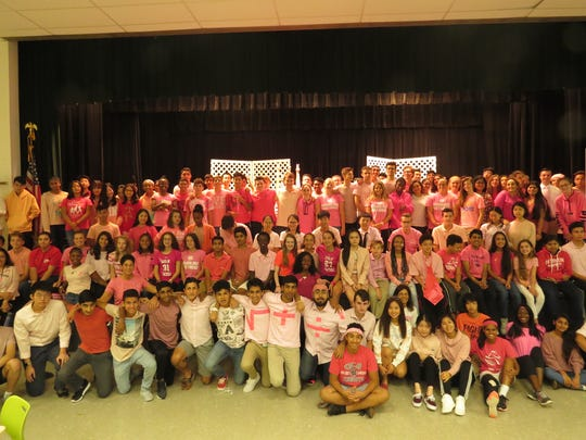 "The senior class chants ""2018"" and goes wild during Spirit Week.  The W+H student body shows its support for Breast Cancer Awareness."