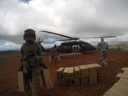 Spc. Darin Bookey, a Black Hawk crew chief with the