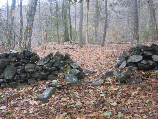 A look at a stone wall crossed by the trail between