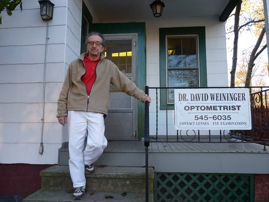 Dr. David Weininger outside of his Easton Avenue optometry office in New Brunswick.