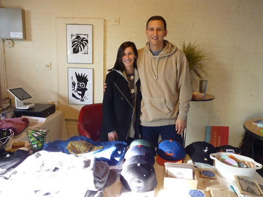 Arnold Weinberg, owner of Modern Art Solutions in Highland Park, with freelance designer and artist Maria Biondo on Small Business Saturday.