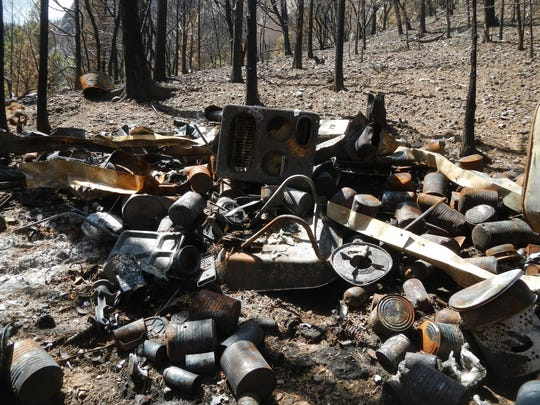 The remains of a cabin filled with explosives discovered during the Brian Head fire.