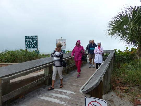 Vanderbilt Beach in North Naples still drew people despite the cloudy, cooler weather Saturday, Dec. 9, 2017. A cold front was forecast to bring near-record lows to Southwest Florida. Temperatures could dip into the low 40s by Sunday morning, Dec. 10.