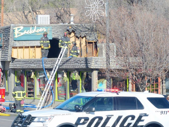 Firemen from the Ruidoso Fire Department took care of small fires on the roof.