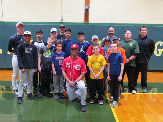 Former MLB player Milt Thompson(center) provides useful tips at Wardlaw+Hartridge Baseball clinic.