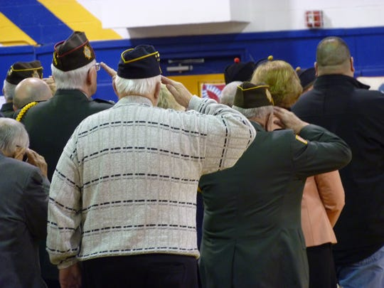 Veterans saluting during the Wreaths Across America event in Manville.