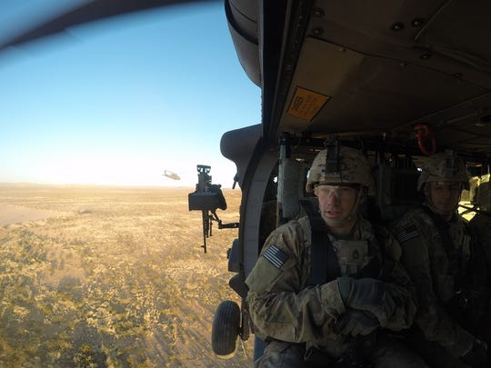 Black Hawk helicopter crews from the 3rd Battalion, 501st Aviation Regiment completed their part of brigade gunnery by doing an air-assault mission with 3rd Brigade's 1-77 Armor.