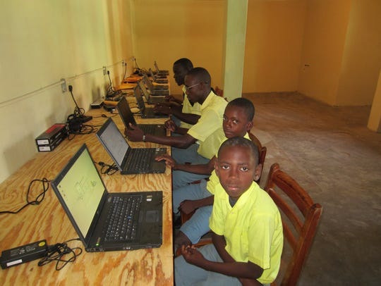 Haitian students at one of Baumann's computer labs.