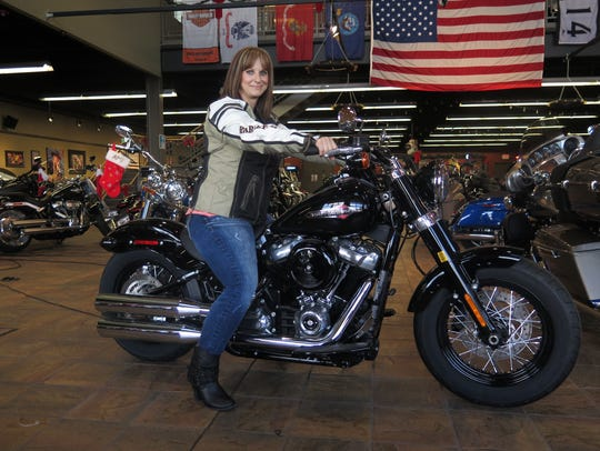 Terri Meehan poses on a 2018 Harley Softail Slim in