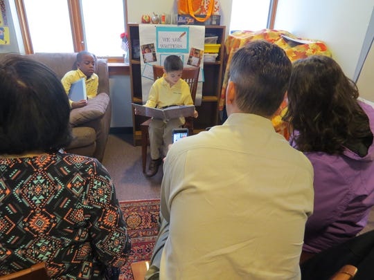 Nathan Chiodo of Westfield, a first grader at The Wardlaw+Hartridge School in Edison, reads his own published work to parents as classmate Brent Xavier of Westfield looks on and waits for his turn.