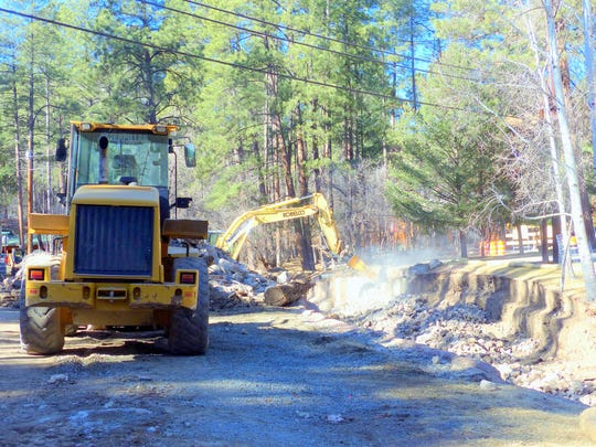 With the Rio Ruidoso diverted and First Bridge removed, Roper Construction crews work Thursday on preparing the channel for the bridge replacement.