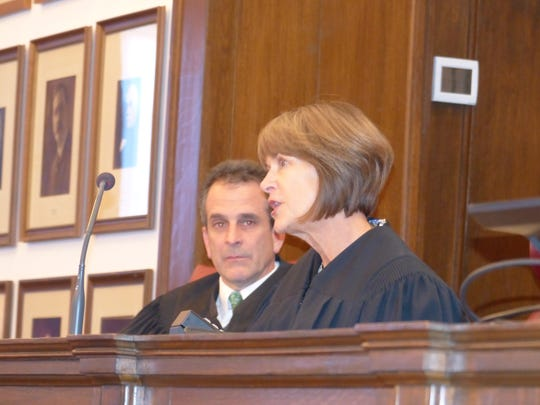 """Worcester County Circuit Court Judge Mary """"Peggy"""" Kent sits at the bench during her investiture on Jan. 19, 2018."""