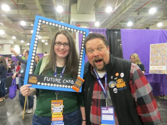 "Justin ""Squigs"" Robertson, creator of Lights of Broadway cards, poses with a cosplayer in the marketplace at BroadwayCon 2018, held from Jan. 26 to 28, 2018, at the Javits Center in Manhattan. Lights of Broadway will have a table at Broadway Flea."