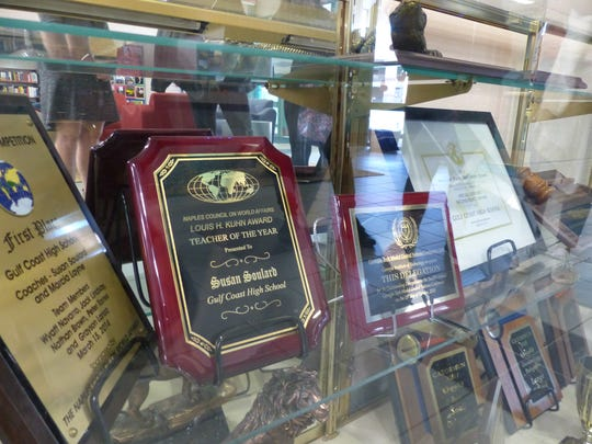 Several Model UN awards are displayed inside a glass case in the library at Gulf Coast High School. In mid-February, about 20 Model UN students will travel to the North American Invitational Model United Nations Conference (NAIMUN) in Washington, D.C. for a chance to earn national recognition once again.
