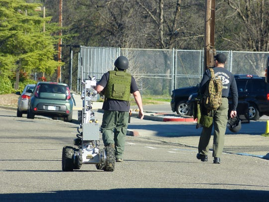 ​The Shasta County Sheriff's Office bomb squad uses a robot to inspect suspicious devices at a home in north Redding on Feb. 15.    ​