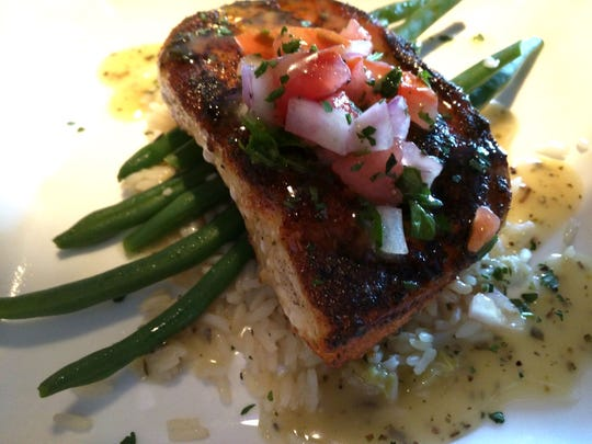 Chill and Grill's locally-caught mahi-mahi with coconut and orange Pico de Gallo served over rice and green beans.