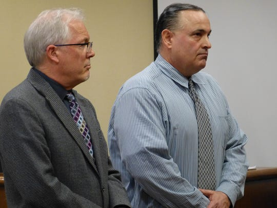 Stephen Giordano, right, and Shasta County Public Defender Jeff Gorder rise as the jury enters the courtroom.