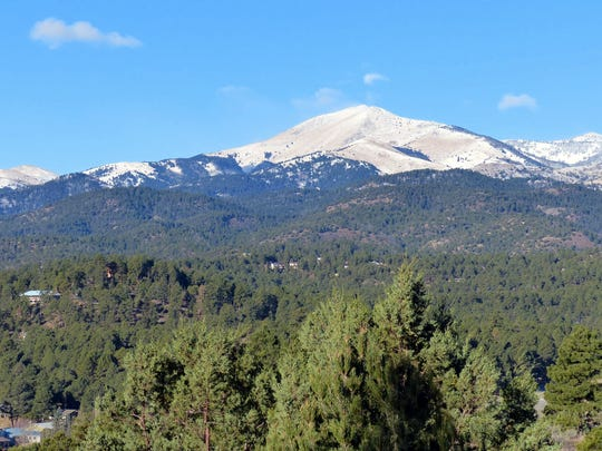 2018 file photo showing snow cover on the Sierra Blanca peak.