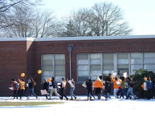 South Plainfield High School students walked out of classes Wednesday in solidarity with the nationwide movement to call on stricter gun control laws.