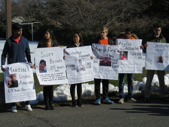 During the March 14 National School Walkout event, Wardlaw + Hartridge School students in Edison, Rohan Arvindh of Edison, Tiffany Le of South Plainfield, Cathy Bi of Edison, CJ Stueck of Scotch Plains, Soorya Srinivas and Stan DeLaurentiis of Plainfield,  hold banners in remembrance of the victims killed in Florida on Feb. 14