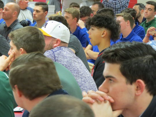 Players listen intently during Autism Awareness Baseball Challenge reception