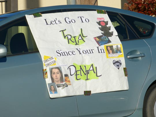 A car parked Monday on West Street near the John Balma Justice Center had a message directed to Kendra Andersen-Schwegerl.