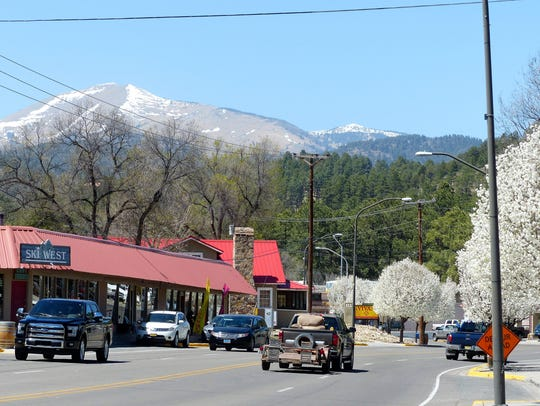As drivers near Upper Canyon, Sierra Blanca Peak looms larger and the white blossoms pick up the color of remaining snow in the mountains.