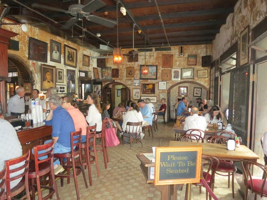 The Napoleon House, a restaurant set in a landmark French Quarter building, is known for muffuletta sandwiches.