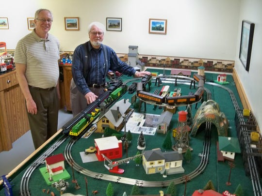 Clipper City Model Railroad Club will present its spring train show this weekend. Pictured with the O gauge train layout are Rick Hoffman and Paul Kopidlansky.